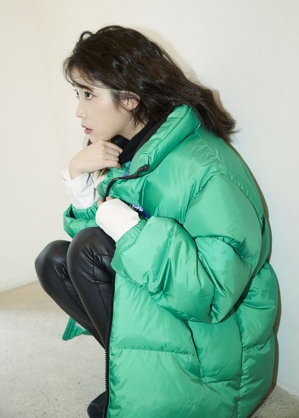 Tags: K-Pop, IU, Green Outerwear, Black Pants, Serious, Crouching, Leather Pants, New Balance