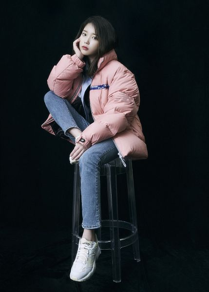 Tags: K-Pop, IU, Shoes, Hand On Head, Sneakers, Arm Support, Jeans, Dark Background, Hand On Cheek, Pink Outerwear, Chair, Black Background