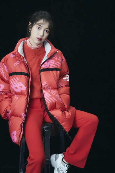 Tags: K-Pop, IU, Hand In Pocket, Red Pants, Sitting On Chair, Dark Background, Red Outerwear, Shoes, Red Lips, Sneakers, Serious, Chair