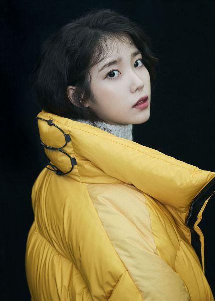 Tags: K-Pop, IU, Dark Background, Black Background, Yellow Outerwear, Serious, New Balance