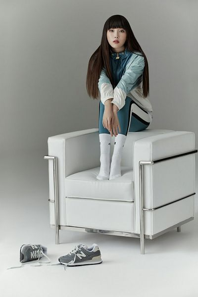 Tags: K-Pop, IU, Shoeless, Jumpsuit, Chair, Serious, Gray Background, Armchair, New Balance