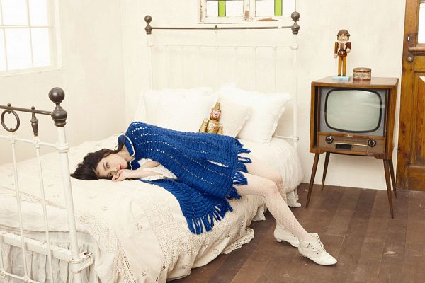 Tags: K-Pop, IU, Blue Outerwear, Boots, Laying On Side, Fishnets, Blue Jacket, Pillow, On Bed, Bed, Laying Down, Television