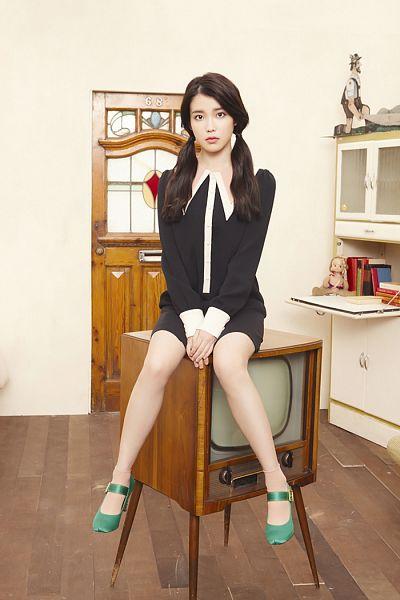 Tags: K-Pop, IU, Green Footwear, Door, Black Dress, Socks, Television, Twin Tails, Clasped Hands, Light Background, High Heels, Bare Legs