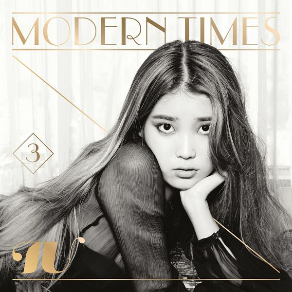 Tags: K-Pop, IU, Black Dress, Chin In Hand, Curtain, Laying Down, Gray Background, Laying On Stomach, Text: Artist Name, Monochrome, Black Eyes, Black Outfit