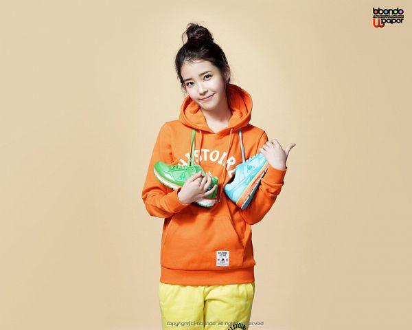 Tags: K-Pop, IU, Hair Buns, Orange Shirt, Hoodie, Single Bun, Hair Up, Shoes, Le Coq Sportif