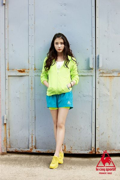 Tags: K-Pop, IU, Hoodie, Blue Shorts, Hand In Pocket, Green Shirt, Shorts, Crossed Legs (Standing), Le Coq Sportif
