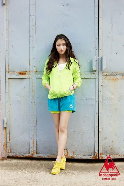 Tags: K-Pop, IU, Crossed Legs (Standing), Hoodie, Blue Shorts, Hand In Pocket, Green Shirt, Shorts, Le Coq Sportif