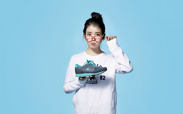 Tags: K-Pop, IU, Hair Up, Glasses, Blue Background, Shoes, Black Footwear, Sneakers, Wallpaper, HD Wallpaper