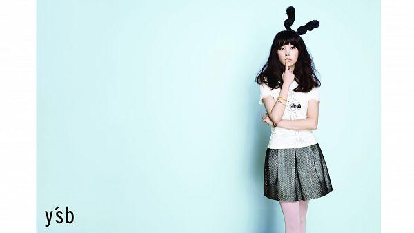 Tags: K-Pop, IU, Black Headwear, Make Up, Finger To Lips, Black Skirt, Pleated Skirt, Blue Background, Bracelet, White Border, Skirt, Pantyhose