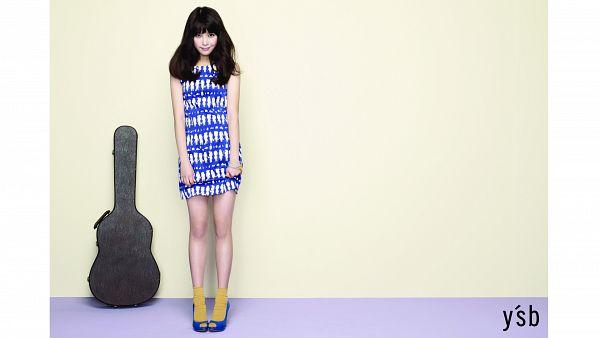 Tags: K-Pop, IU, Blue Footwear, Skirt, Blue Dress, Holding Skirt, Guitar, Blue Outfit, White Border, Full Body, Text: Brand Name, Yellow Legwear