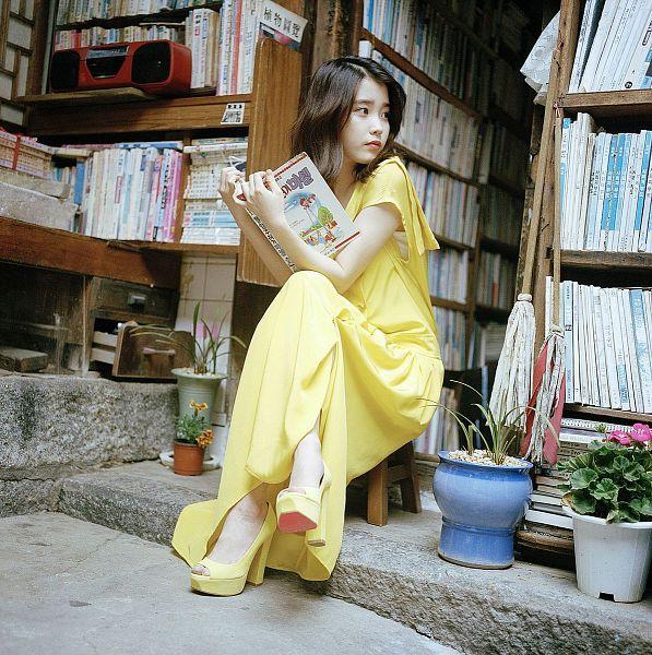 Tags: K-Pop, IU, Yellow Outfit, Sitting, Yellow Dress, Medium Hair, Flower, Book, Crossed Legs, Bent Knees, Flower Bookmark