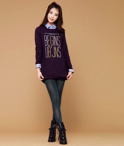 Tags: K-Pop, IU, Blue Shirt, Black Footwear, Crossed Legs (Standing), Sweater, English Text, Black Legwear, Shoes, Purple Shirt, Boots, Brown Background