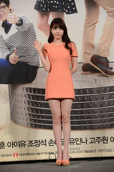 Tags: K-Drama, K-Pop, IU, Full Body, Arms Behind Back, Korean Text, Wave, Orange Footwear, Orange Dress, High Heels, Bare Legs, Press Conference