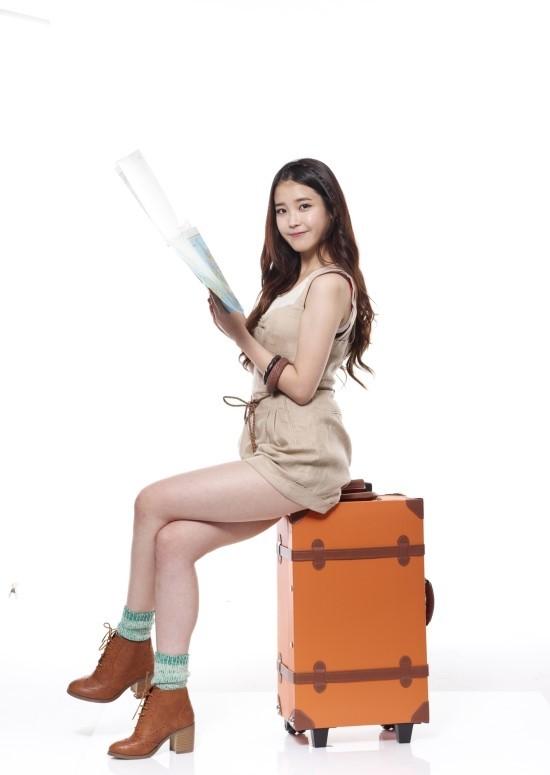 Tags: K-Pop, IU, Bare Shoulders, Map, Suitcase, Sleeveless Dress, High Heels, Brown Dress, Light Background, Brown Outfit, Bracelet, Crossed Legs