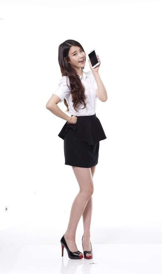 Tags: K-Pop, IU, White Background, Hand On Hip, High Heels, Phone, Black Skirt, Skirt, Smartphone, Light Background, Short Sleeves, 11st