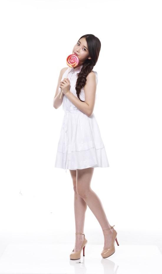 Tags: K-Pop, IU, White Dress, Single Braid, White Outfit, Sleeveless, Sleeveless Dress, Lollipop, Candy, Braids, Light Background, Brown Footwear