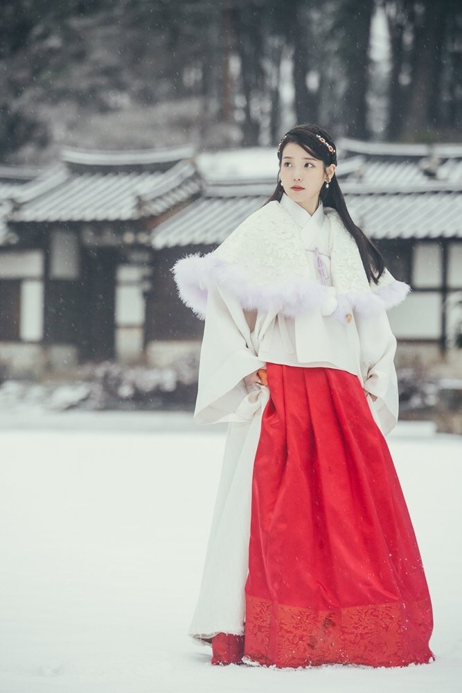 Tags: K-Pop, K-Drama, IU, Tree, House, Standing, Looking Ahead, Hair Ornament, Snow, Traditional Clothes, Fur, Jewelry