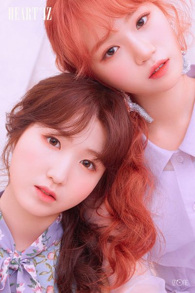 Tags: J-Pop, K-Pop, IZ*ONE, AKB48, Kim Chaewon, Hitomi Honda, Purple Shirt, Text: Album Name, Serious, Red Hair, Two Girls, Floral Print