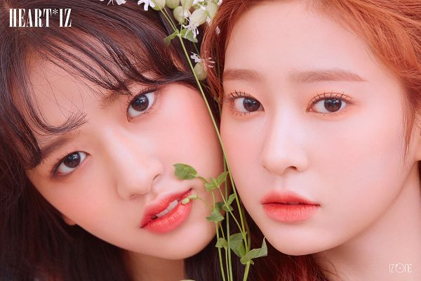 Tags: K-Pop, IZ*ONE, Kim Minju, Ahn Yujin, Cheeks Together, Serious, Red Hair, Two Girls, Flower, Duo, Red Lips, Text: Album Name