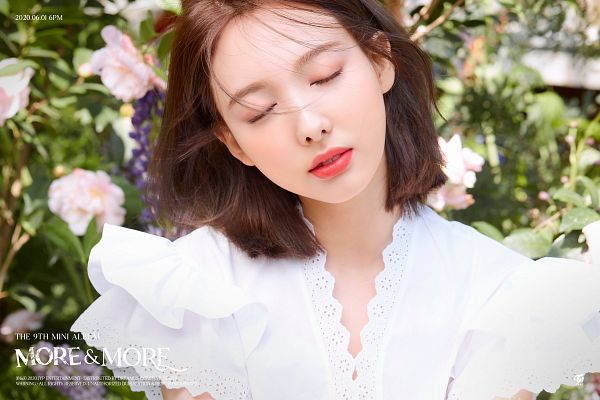 Tags: K-Pop, Twice, Im Nayeon, Text: Company Name, Medium Hair, Eyes Closed, Text: Calendar Date, Outdoors, Text: Album Name, MORE & MORE