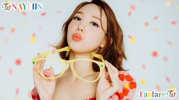 Tags: K-Pop, Twice, Fanfare, Im Nayeon, Light Background, Pink Shirt, White Background, Glasses, Text: Artist Name, Blow a Kiss, Medium Hair, Kiss