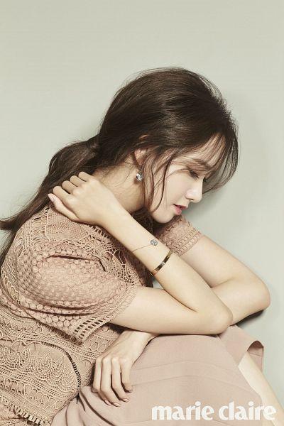 Tags: K-Pop, Girls' Generation, Im Yoona, Brown Shirt, Brown Background, Eyes Half Closed, Bracelet, Hand On Neck, Ponytail, Text: Magazine Name, Side View, Brown Skirt