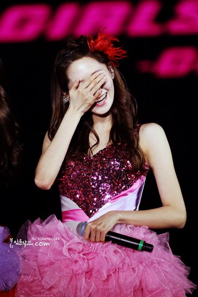Tags: K-Pop, Girls' Generation, Im Yoona, Sleeveless Dress, Laughing, Dark Background, Sleeveless, Red Headwear, Pink Outfit, Covering Eyes, Black Background, Pink Dress