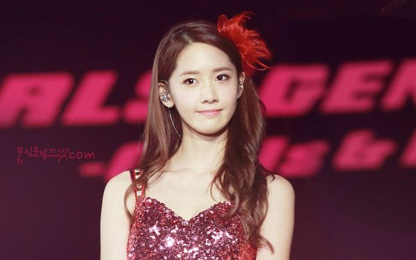 Tags: K-Pop, Girls' Generation, Im Yoona, Bare Shoulders, Sleeveless, Sleeveless Dress, Collarbone, Pink Outfit, Pink Dress, Text: Artist Name, Brown Background, Looking Away