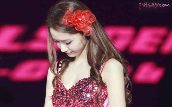 Tags: K-Pop, Girls' Generation, Im Yoona, Dark Background, Eyes Closed, Red Headwear, Looking Down, Sleeveless, Text: Artist Name, Pink Outfit, Bare Shoulders, Black Background