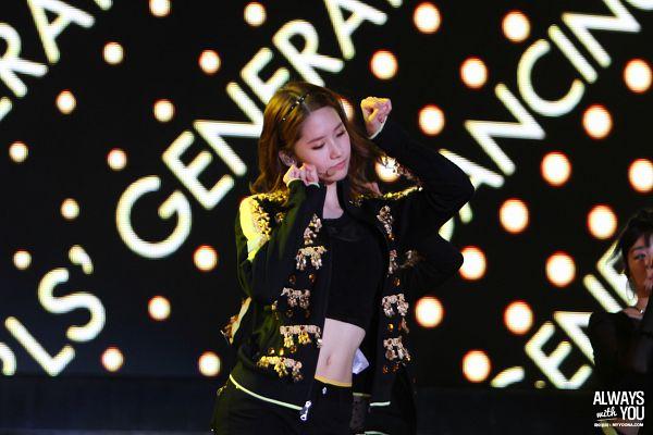 Tags: K-Pop, Girls' Generation, Dancing Queen, Im Yoona, Black Background, Eyes Closed, Black Shorts, Midriff, Fist, Dark Background, Black Jacket, Shorts