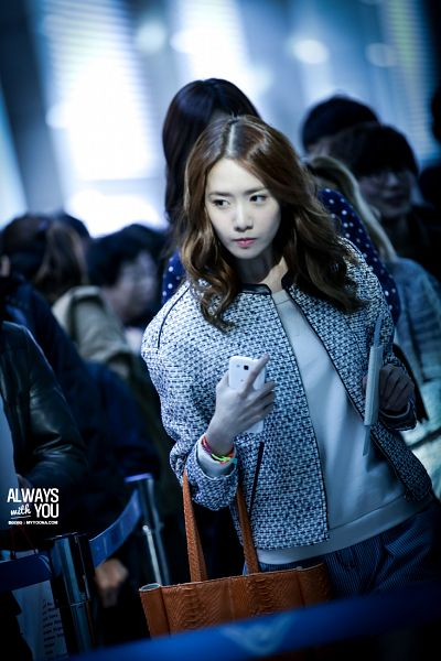 Tags: K-Pop, Girls' Generation, Im Yoona, Smartphone, White Outerwear, White Jacket, Gray Pants, Phone, Looking Away, Airport, Passport, Always With You