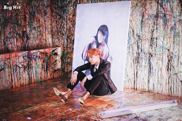 Tags: K-Pop, BTS, J-Hope, Sitting On Ground, Black Outerwear, Black Pants, Black Jacket, Black Eyes, Red Hair, Canvas, Wings (Album)
