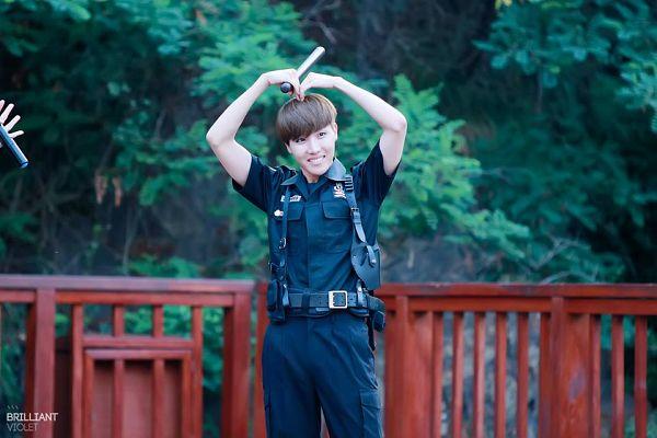 Tags: K-Pop, BTS, J-Hope, Tree, Grin, Short Sleeves, Fence, Overalls, Heart Gesture, Plant, Belt, Black Pants