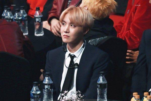Tags: K-Pop, BTS, J-Hope, Bottle, Tie, Black Outerwear, Serious, Water, Pink Hair, Black Jacket, Earbuds