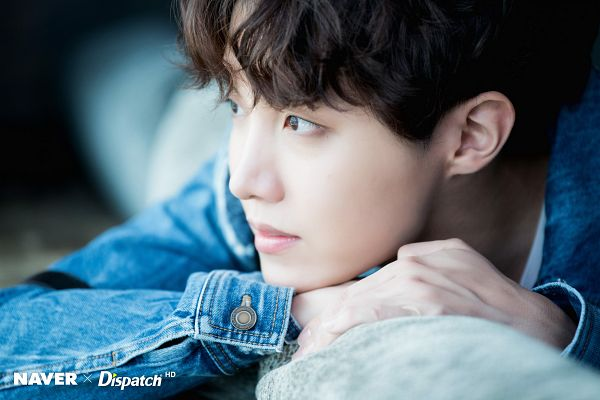 Tags: K-Pop, BTS, J-Hope, Couch, Denim Jacket, Looking Away, Wavy Hair, Dark Background, Dispatch