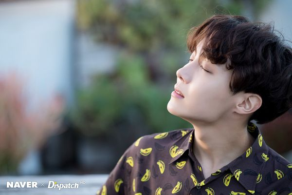 Tags: K-Pop, BTS, J-Hope, Close Up, Side View, Collar (Clothes), Eyes Closed, Outdoors, Wavy Hair, Plant, Dispatch