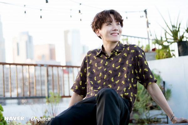 Tags: K-Pop, Bangtan Boys, J-Hope, Short Sleeves, Day, Pants, Plant, Bracelet, Black Eyes, City, Grin, Table