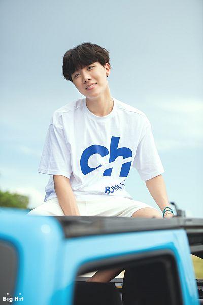 Tags: K-Pop, BTS, J-Hope, Outdoors, Bracelet, Text: Company Name, Sky, English Text, Car, Short Sleeves, Grin, White Shorts