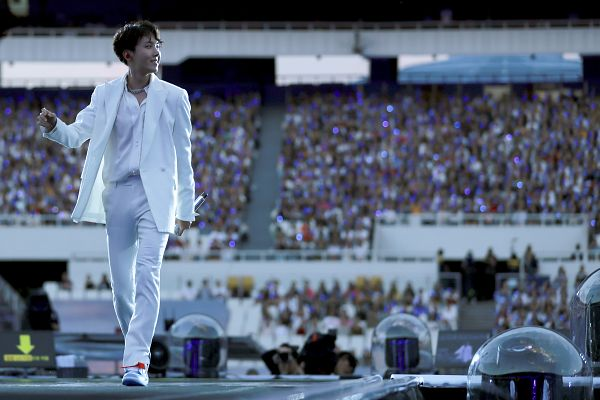 Tags: K-Pop, BTS, Trivia: Just Dance, J-Hope, Holding Object, White Footwear, Bracelet, Grin, Looking Away, White Outfit, White Outerwear, Shoes