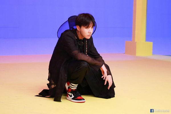 Tags: K-Pop, BTS, IDOL (Song), J-Hope, Traditional Clothes, Black Pants, Text: Artist Name, Korean Clothes, English Text, Serious, Hat, Crouching