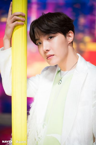Tags: K-Pop, BTS, Boy With Luv, J-Hope, White Jacket, Necklace, White Outerwear, Green Shirt, Serious, English Text, Lamp Post, Dispatch