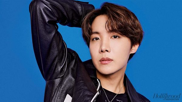 Tags: K-Pop, BTS, J-Hope, Blue Background, Serious, Text: Magazine Name, Black Jacket, One Arm Up, Necklace, Contact Lenses, Leather Jacket, Magazine Scan