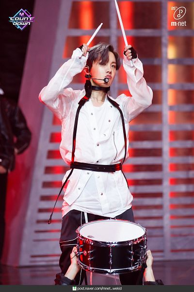 Tags: Television Show, K-Pop, BTS, ON, J-Hope, Drumsticks, Black Gloves, Text: URL, English Text, Musical Instrument, Fingerless Gloves, Pouting