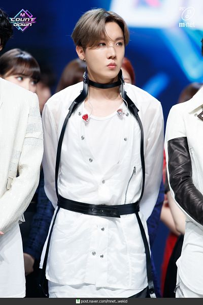 Tags: Television Show, K-Pop, BTS, J-Hope, Arms Behind Back, English Text, Black Gloves, Earbuds, Looking Away, Fingerless Gloves, Harness, Group