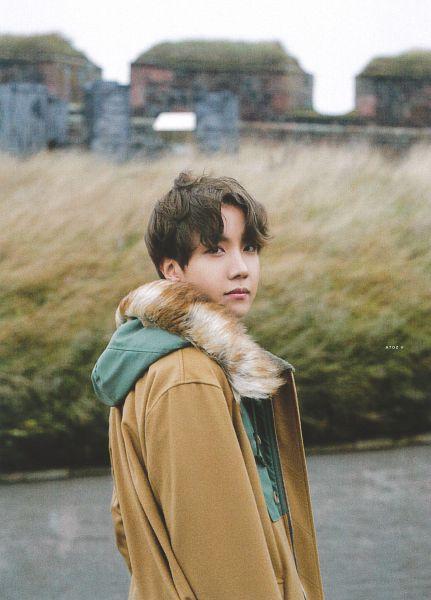 Tags: K-Pop, BTS, J-Hope, Fur Trim, Black Eyes, Outdoors, Grass, Wind, Brown Outerwear, Flowing Hair, Coat, Fur