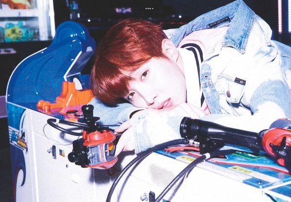 Tags: K-Pop, BTS, J-Hope, Contact Lenses, Dark Background, Arcade, Laying Down, Denim Jacket, Pink Shirt, Indoors, Red Hair, Blue Jacket