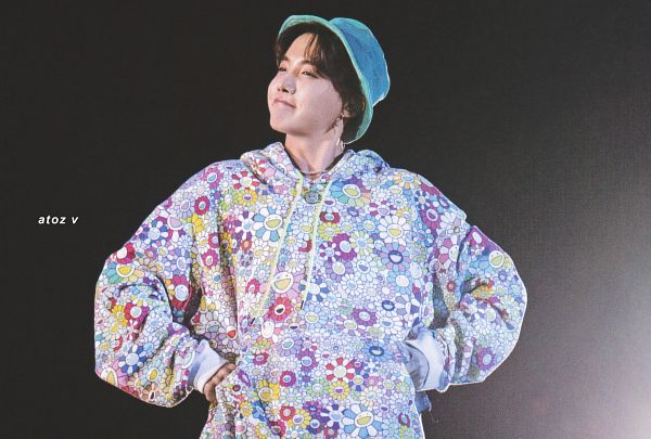 Tags: K-Pop, BTS, J-Hope, Earbuds, Necklace, Hoodie, Hat, Dark Background, Holding Object, Floral Print, Looking Away, Hand On Hip