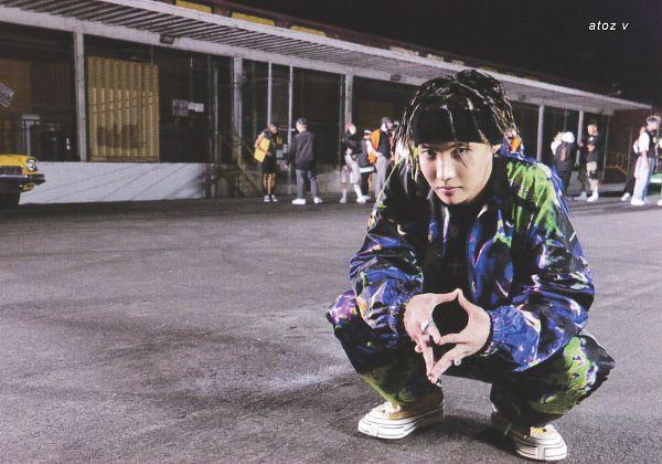 Tags: K-Pop, BTS, Chicken Noodle Soup, J-Hope, Purple Outerwear, Crouching, Headdress, Green Outerwear, Ring, Serious, Night, Dreadlocks