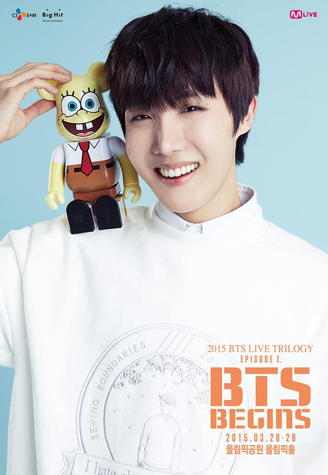 Tags: K-Pop, BTS, J-Hope, Grin, Text: Artist Name, Blue Background, Toy, Text: Company Name, Holding Object, Text: Calendar Date, Poster, BTS Live Trilogy Episode I: BTS Begins