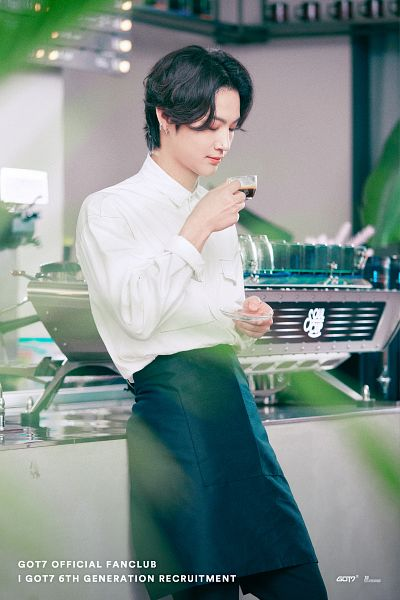 Tags: K-Pop, Got7, JB, Cup, Black Pants, Piercing, English Text, Apron, Medium Hair, Coffee, Looking Down, Text: Artist Name